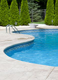 Swimming pool. Generic small fenced swimming pool with diving board Royalty Free Stock Image