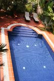 Swimming pool. Beautiful swimming pool in a Siem Reap hotel (Cambodia Royalty Free Stock Photos