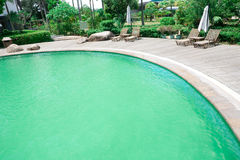 Swimming pool. Sunny outdoor swimming pool in resort Royalty Free Stock Images