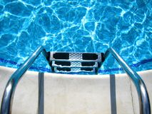 Swimming pool. Steps in a swimming pool with water royalty free stock photos