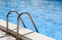 Swimming Pool Ladder. Swimming pool entrance ladder close up royalty free stock photography
