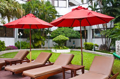Swimming-pool. The swimming-pool and red umbrellas in hotel Stock Image