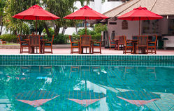 Swimming-pool. The swimming-pool and red umbrellas in hotel Stock Photos
