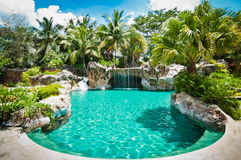 Swimming Pool. View of a swimming pool with artificial waterfall Stock Image