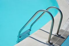 Swimming pool. With clear water and metal ladder Royalty Free Stock Photo