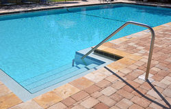 Swimming pool. Rail and steps of a swimming pool Royalty Free Stock Photos