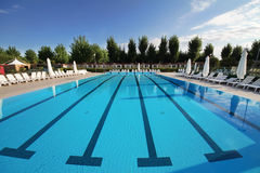 Swimming pool. Located in the open. A calm, clear blue water Royalty Free Stock Images