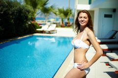 By swimming pool Royalty Free Stock Image