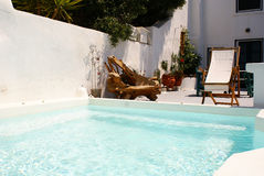 Swimming pool. Pool and a special chair from olive tree royalty free stock photography