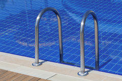 Swimming pool. A close-up photograph of swimming pool and ladder Stock Photography