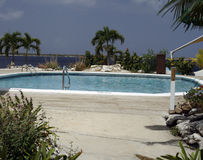 Swimming pool. Outdoor hotel swimming pool in caribbean Royalty Free Stock Images