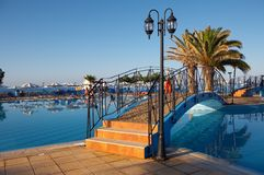 Swimming pool. With bridges and palm trees Stock Photos
