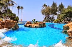 Swimming pool. With view on sea, Bintan island, Indonesia Royalty Free Stock Photos