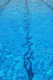 Swimming pool. Vertical closeup of a swimming pool with rippled water and lane stripes Royalty Free Stock Photo