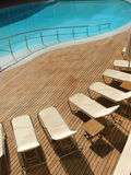Swimming pool. Luxury swimming pool surrounded by wooden floor royalty free stock photography