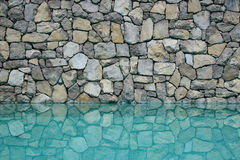 Swimming pool. Wall reflected on the water Royalty Free Stock Images