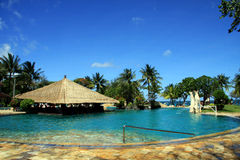 Swimming pool. Tropical vacation. Swimming pool of luxury hotel with bungalo bar Stock Photo