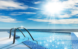 Swimming pool. Luxury home swimming pool near the sea Royalty Free Stock Photos