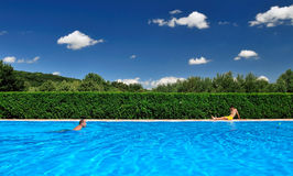 Swimming Pool. Crystal blue water filled swimming pool Stock Image