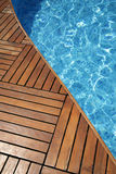 Swimming pool. Fragment of a swimming pool and wooden floor Stock Images
