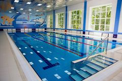 Swimming pool. Empty indoors public swimming pool at day time royalty free stock photography