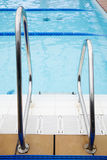 Swimming pool. Blue water, swimming pool, stairs Royalty Free Stock Image