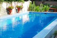 Swimming pool. With clean blue water outdoor Stock Image