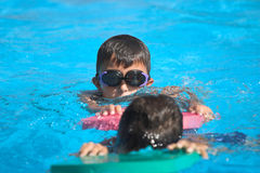 Swimming in pool Royalty Free Stock Photo