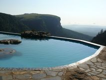Swimming pool. On an edge of a hill Royalty Free Stock Images