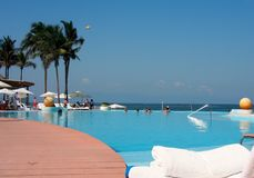 Swimming pool. Beautiful resort swimming pool Royalty Free Stock Photography
