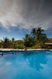 Swimming pool. Under a dramatic sky in Costa Rica Royalty Free Stock Image