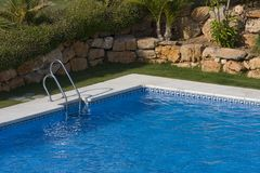 Swimming pool. With blue water Royalty Free Stock Image