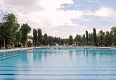 Swimming-pool. Large swimming-pool in a green environment Stock Images