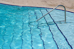 Swimming pool. Beautiful blue fresh swimming pool Royalty Free Stock Photography