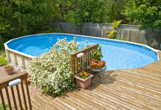 Swimming Pool. An oval shaped above ground swimming pool Stock Image