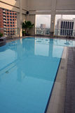 Swimming pool above manila philippines. Hotel swimming pool on hotel roof in Makati city in manila capital city of the philippines royalty free stock image