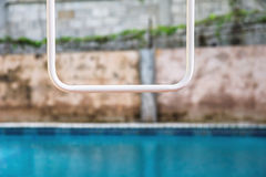 Swimming pool abstract. Backyard swimming pool and wall abstract Royalty Free Stock Images