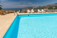 Swimming pool on the Amalfi Coast with views of the Gulf of Naples and Vesuvius. Sorrento. Italy royalty free stock photo