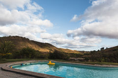 Swimming pool in a amazing hilly landscape Royalty Free Stock Photos
