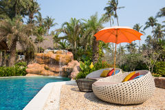 Swimming Pool And Beach Chairs In A Tropical Garden, Thailand Royalty Free Stock Photography
