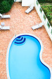 Swimming Pool. An apartment complex's vacant swimming pool Royalty Free Stock Photos