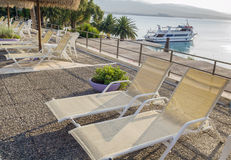 Swimming pool area of hotel with beach. Chair overlooking the sea stock photo