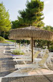 Swimming pool area of hotel. With sun umbrella and beach chair stock photo
