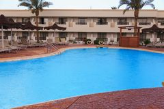 Swimming pool area in the hotel. Relax, vacation concept royalty free stock photography