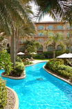 Swimming pool area at luxury hotel Stock Photo