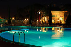 Swimming pool area in night illumination. Antalya, Turkey Stock Photography