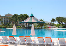 Swimming pool area at popular hotel Stock Photo