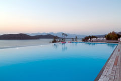 Swimming pool area with sea view, Crete Stock Images