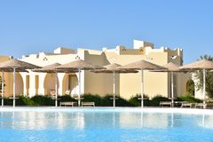 Swimming pool area with umbrellas in the hotel stock photography