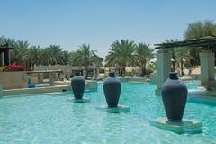 Swimming pool at Bab Al Shams desert arabian resort view Royalty Free Stock Photo